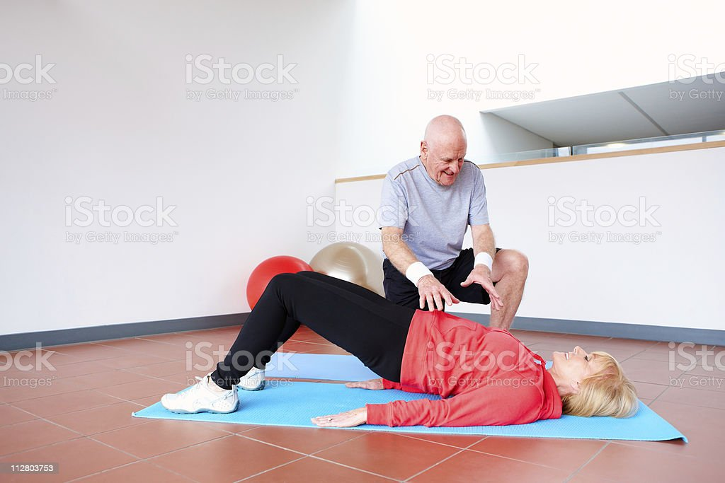 Senior Couple Stretching at the Gym royalty-free stock photo