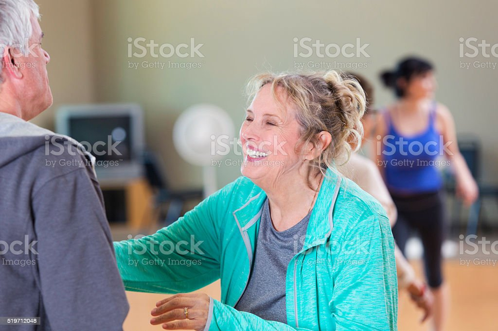 Senior couple take dancing lessons at senior center stock photo