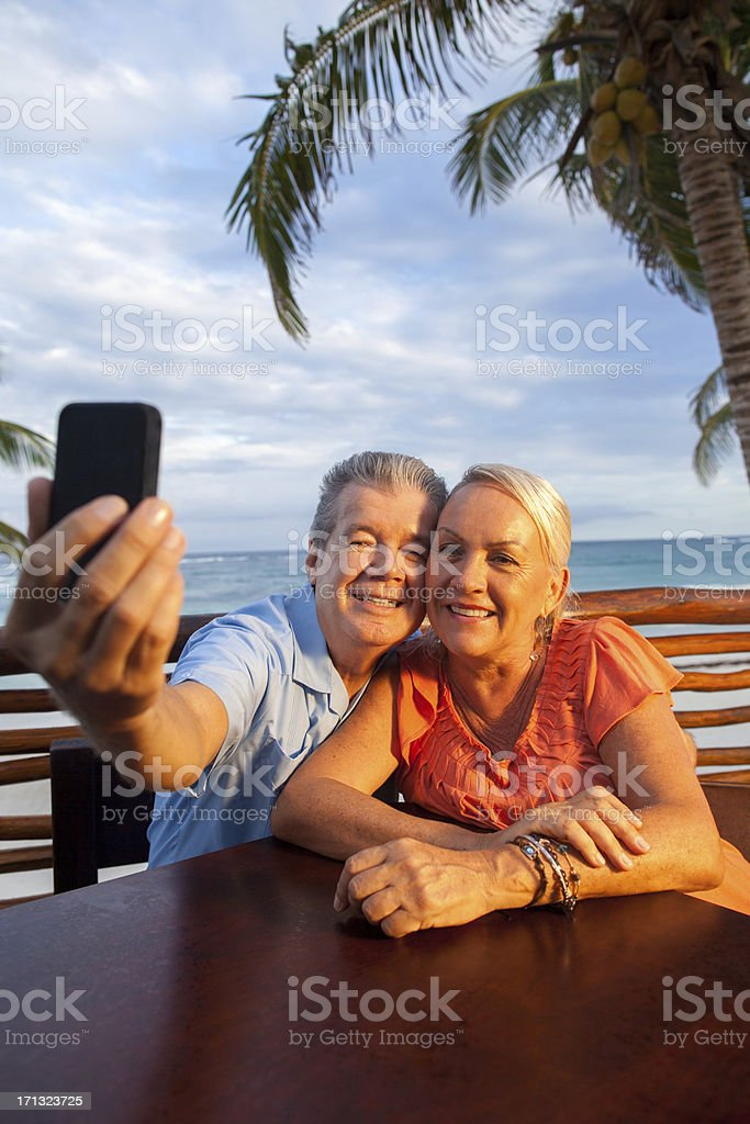 Senior couple taking a picture of themself royalty-free stock photo