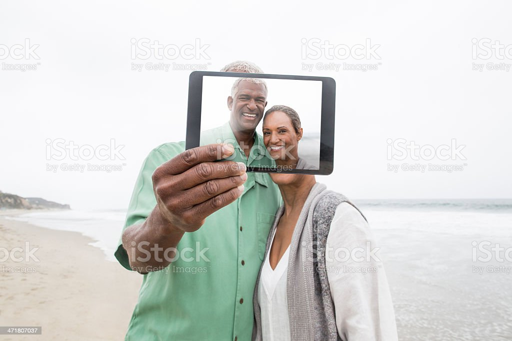 Senior couple taking a picture with tablet royalty-free stock photo