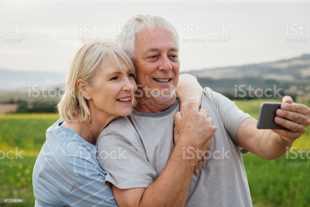 Senior Couple taking a Selfie stock photo