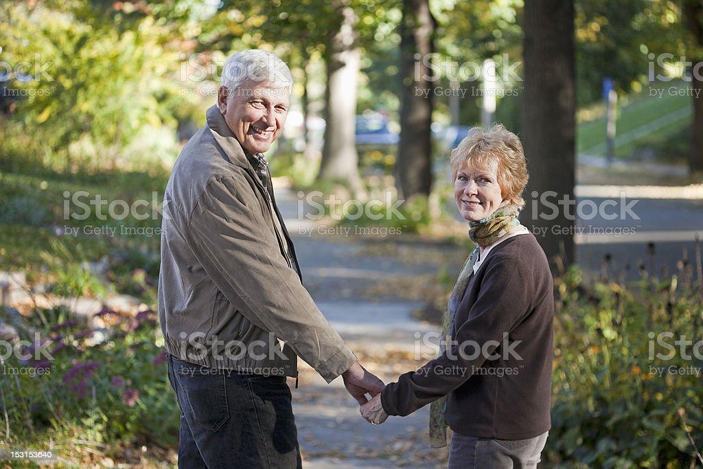 Senior couple taking a walk stock photo