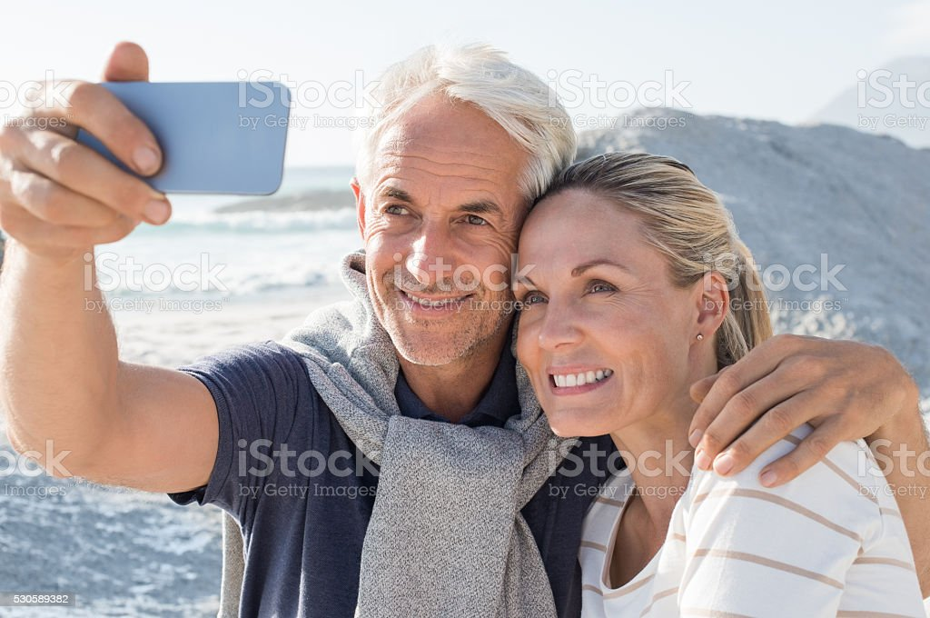 Senior Couple taking selfie stock photo