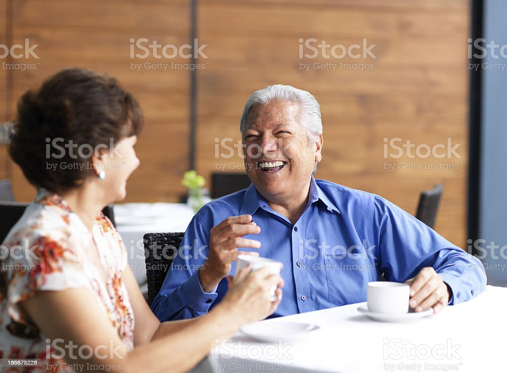Senior couple talking in a restaurant royalty-free stock photo