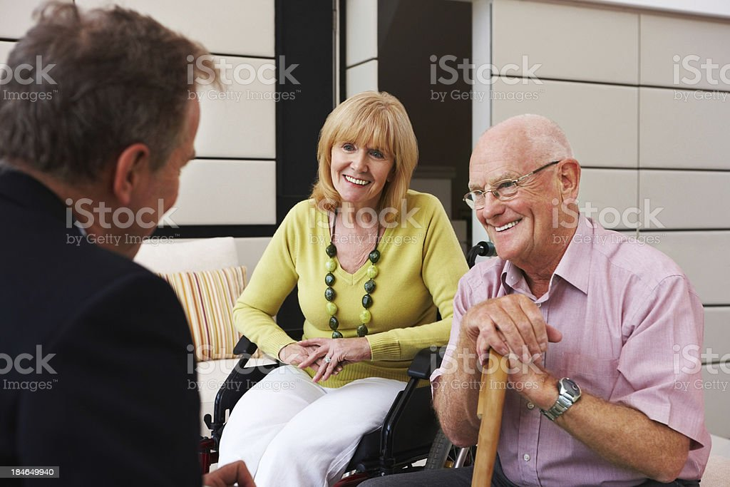 Senior Couple Talking to a Hospital Administrator royalty-free stock photo