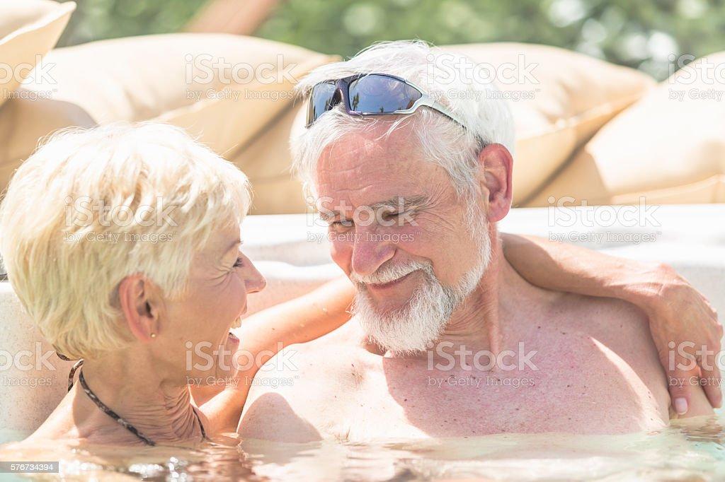 Senior couple toasting together stock photo
