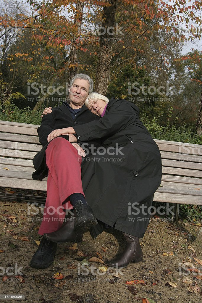 Senior couple together on bench. royalty-free stock photo