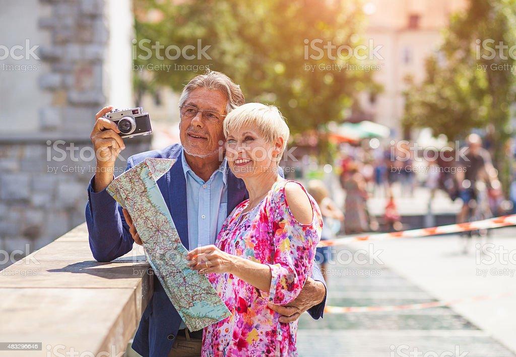 Senior couple tourists at the city stock photo