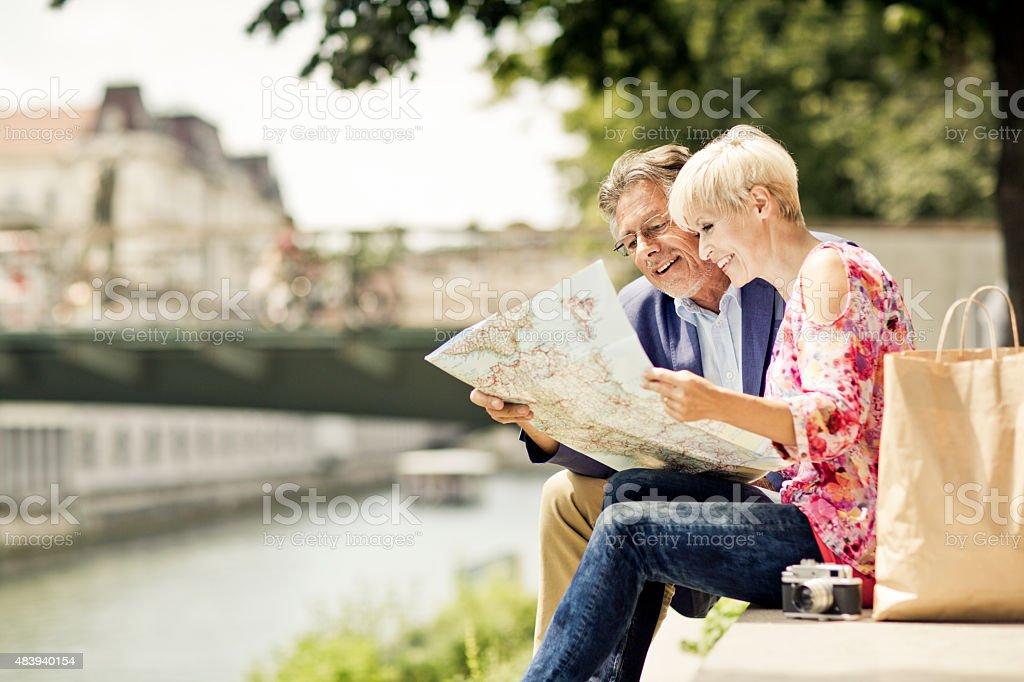 Senior couple tourists in the city stock photo