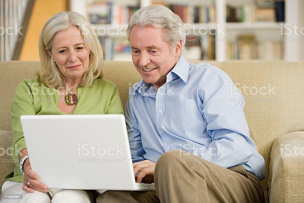 Senior couple using a laptop computer royalty-free stock photo