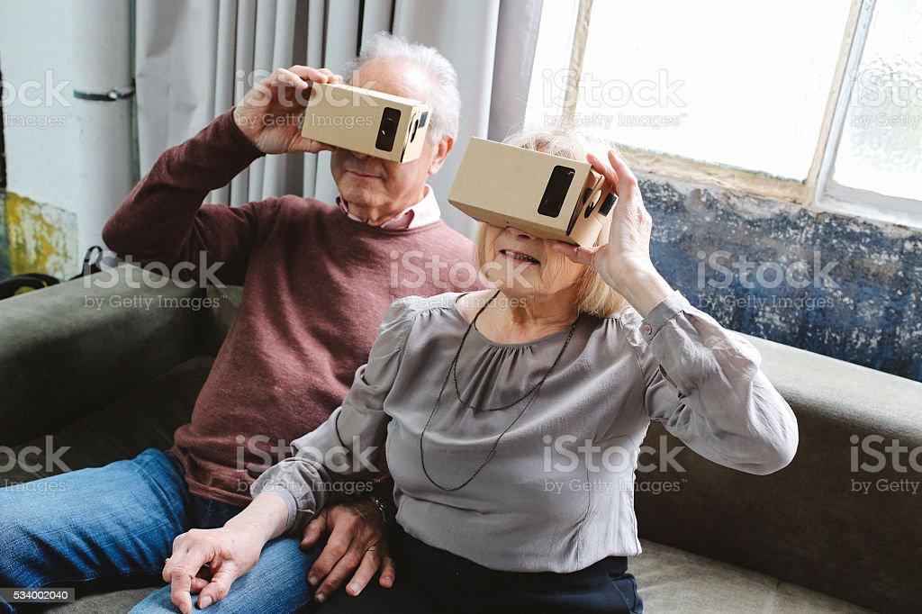 Senior couple using virtual reality headset stock photo
