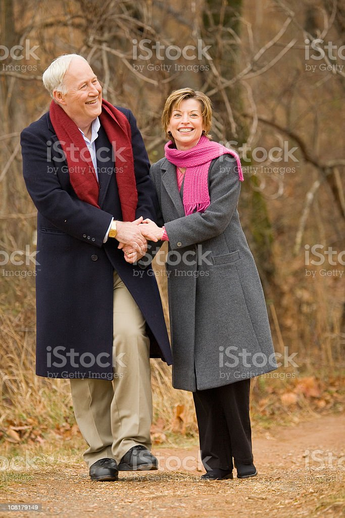 Senior Couple Walking and Holding Hands royalty-free stock photo