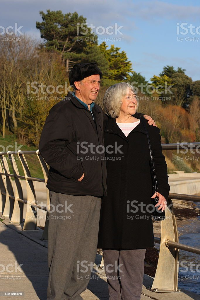 Senior couple walking by the seaside. royalty-free stock photo