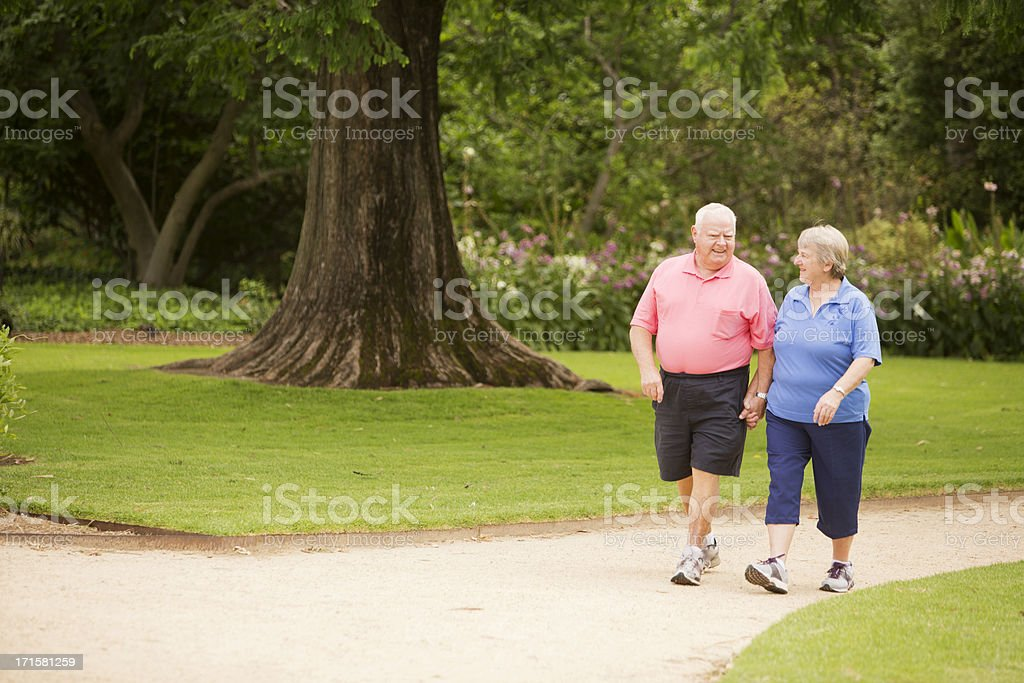 Senior Couple Walking in a Park stock photo