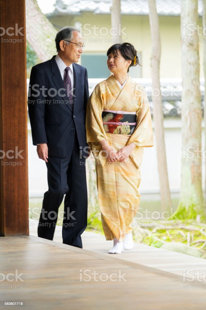 Senior Couple Walking in Buddhist Temple stock photo