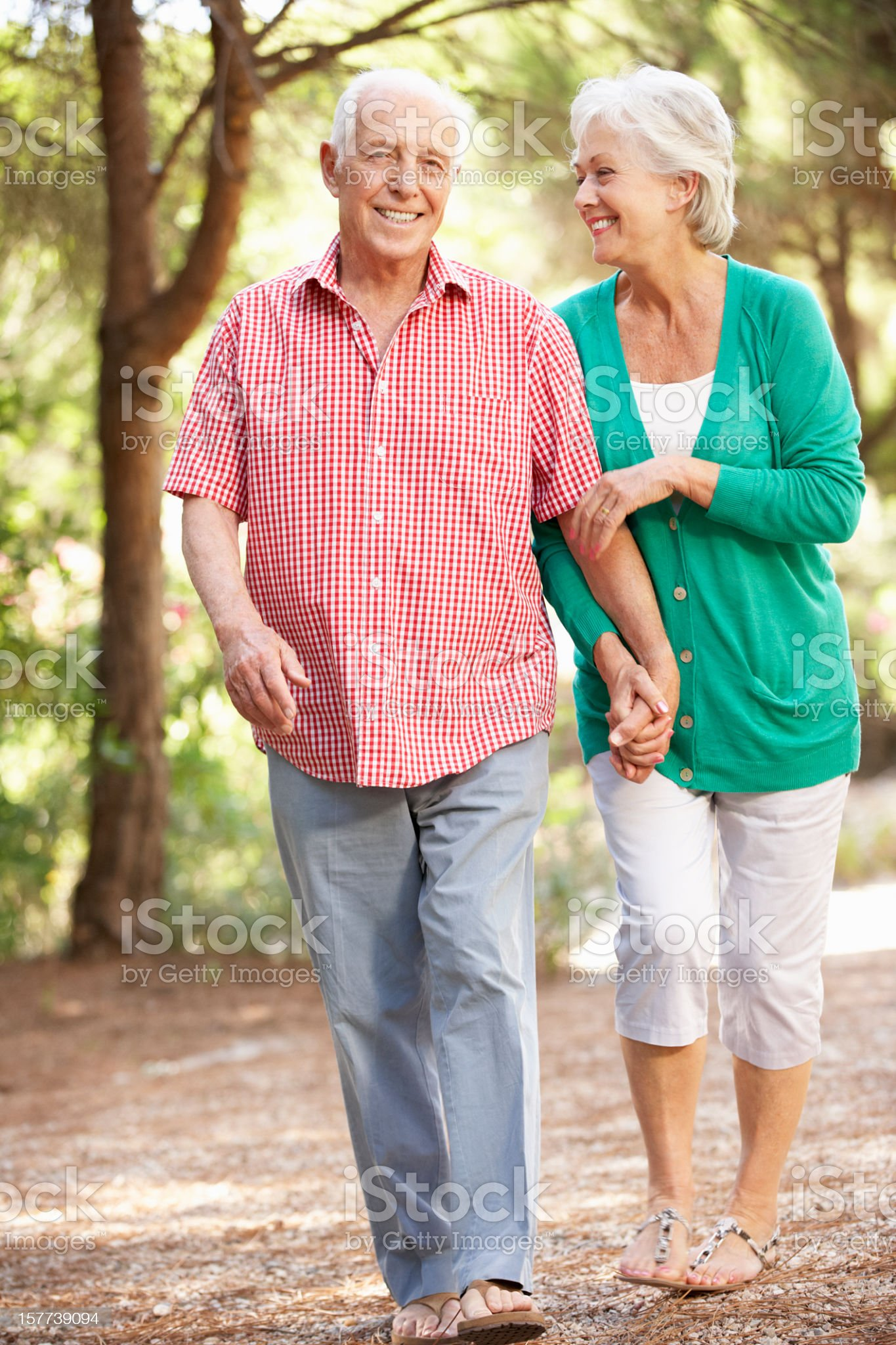 Senior Couple Walking In Countryside Together royalty-free stock photo