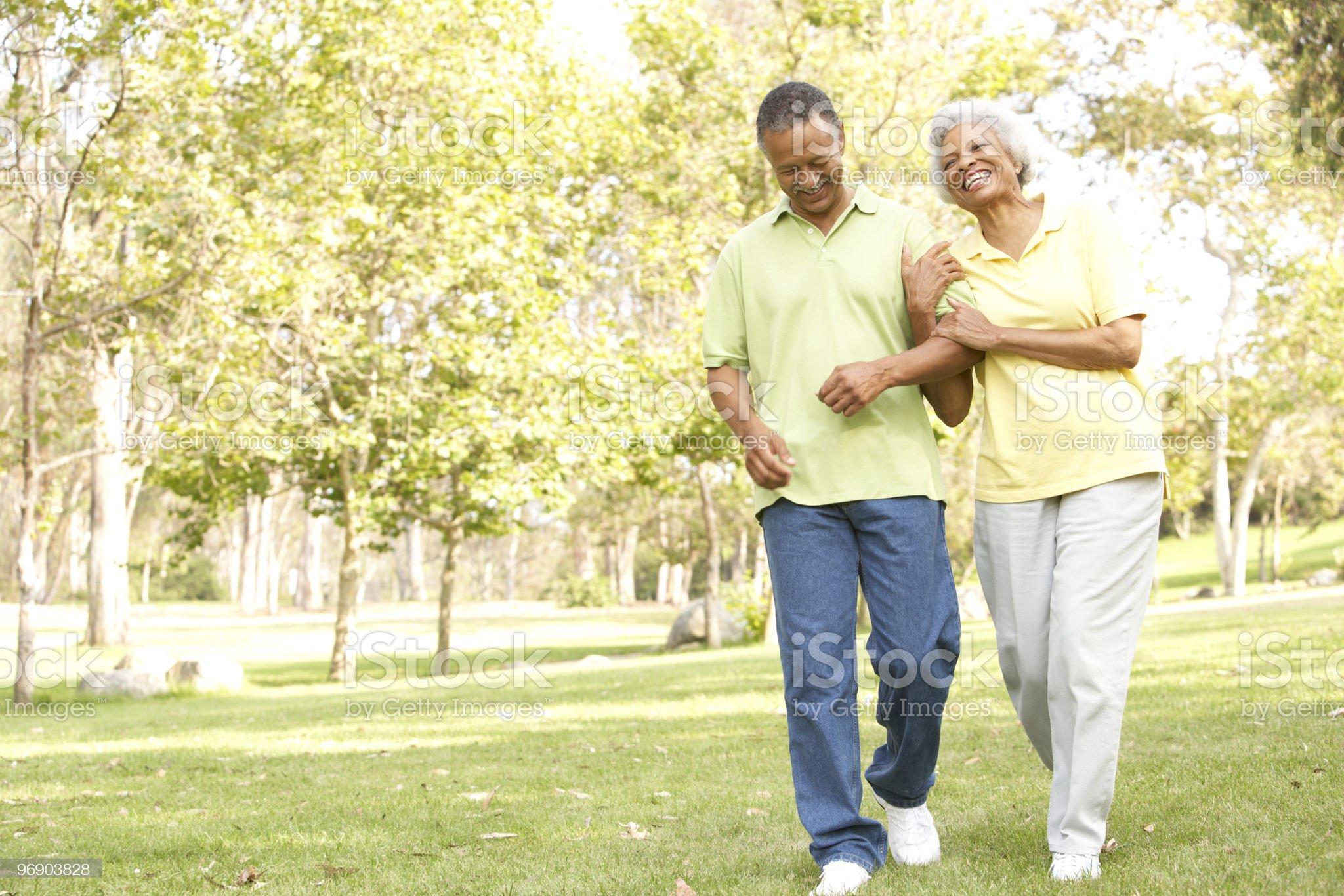 Senior Couple Walking In Park royalty-free stock photo