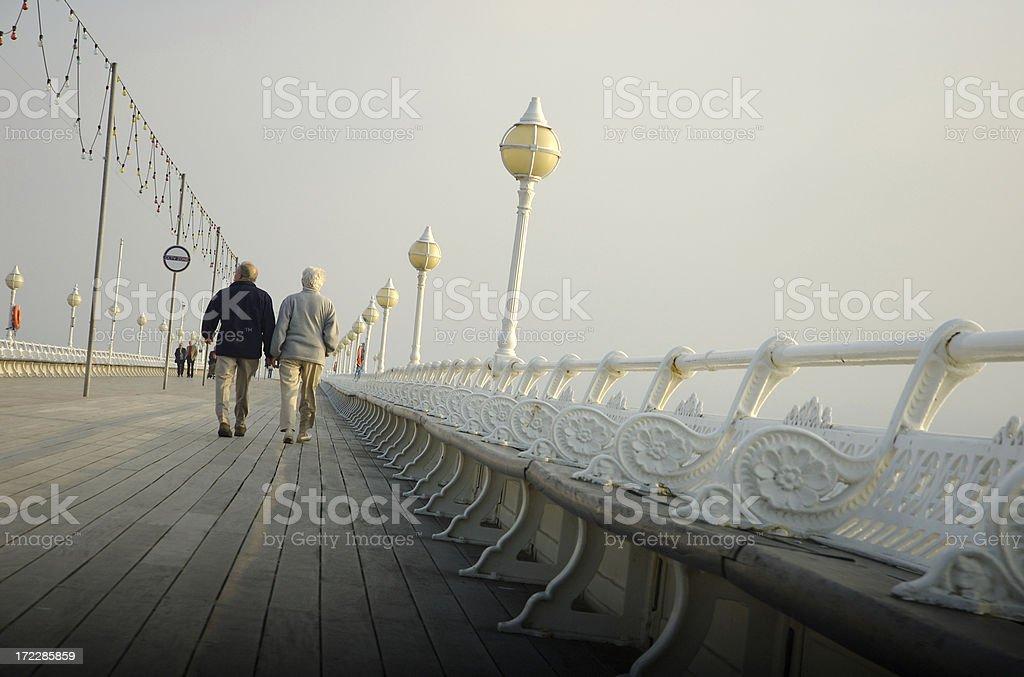 Senior Couple Walking on Pier English Seaside royalty-free stock photo