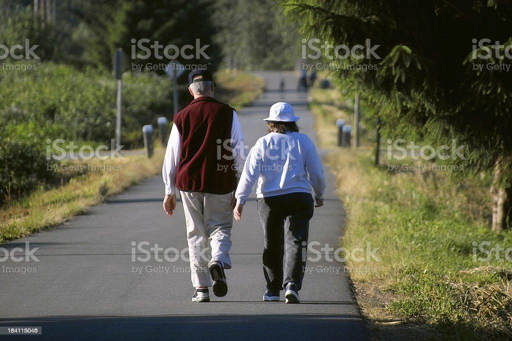 Senior Couple Walking on Trail royalty-free stock photo