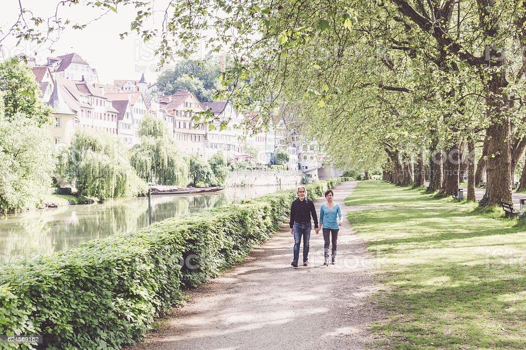 Senior couple walking through a park, Tübingen, Germany stock photo
