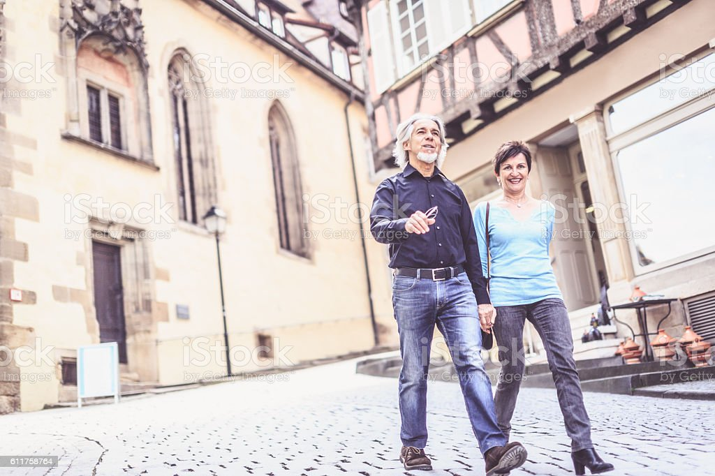 Senior couple walking through the streets of Tübingen, Germany stock photo