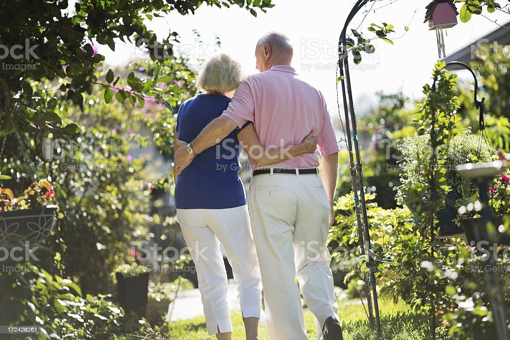 Senior Couple Walking Together In Park royalty-free stock photo