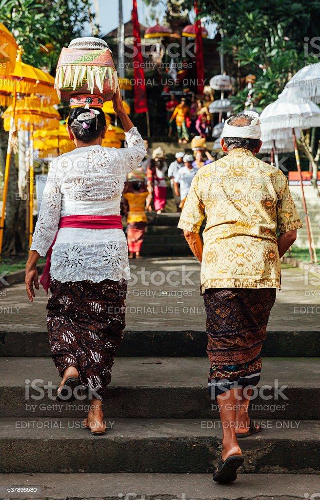 Senior couple walks up the stairs stock photo