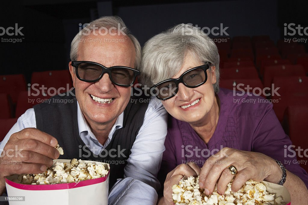 Senior Couple Watching 3D Film In Cinema stock photo