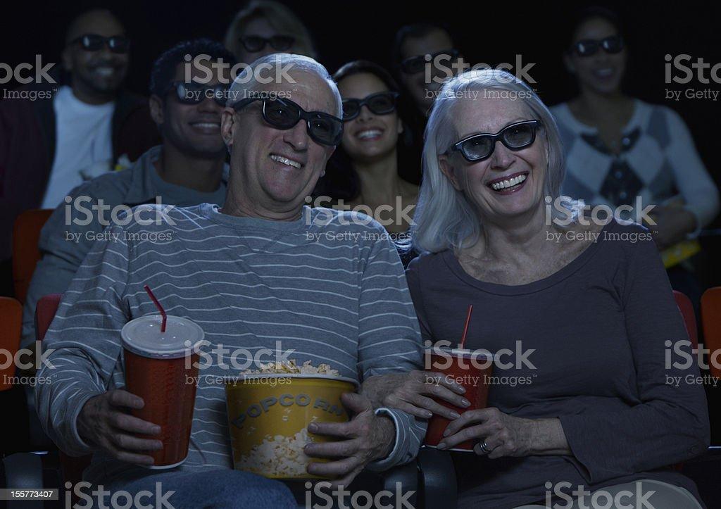 Senior couple watching 3D movie royalty-free stock photo