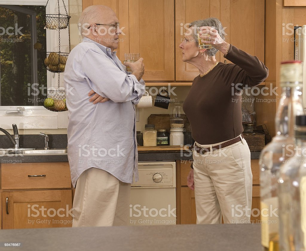 Senior couple with alcohol problems royalty-free stock photo