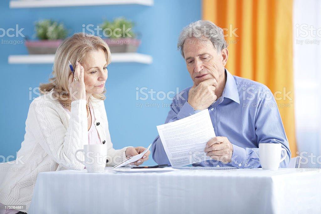 Senior couple with bills. royalty-free stock photo