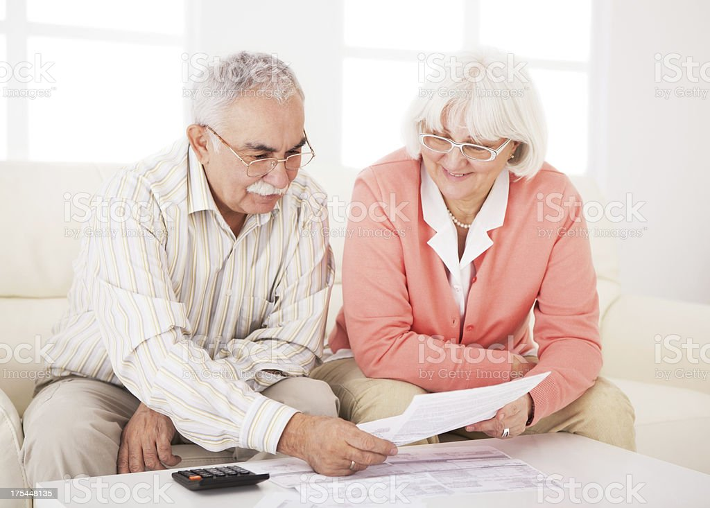 Senior couple with bills. royalty-free stock photo