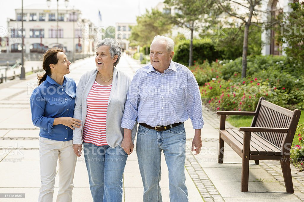 Senior couple with caregiver royalty-free stock photo