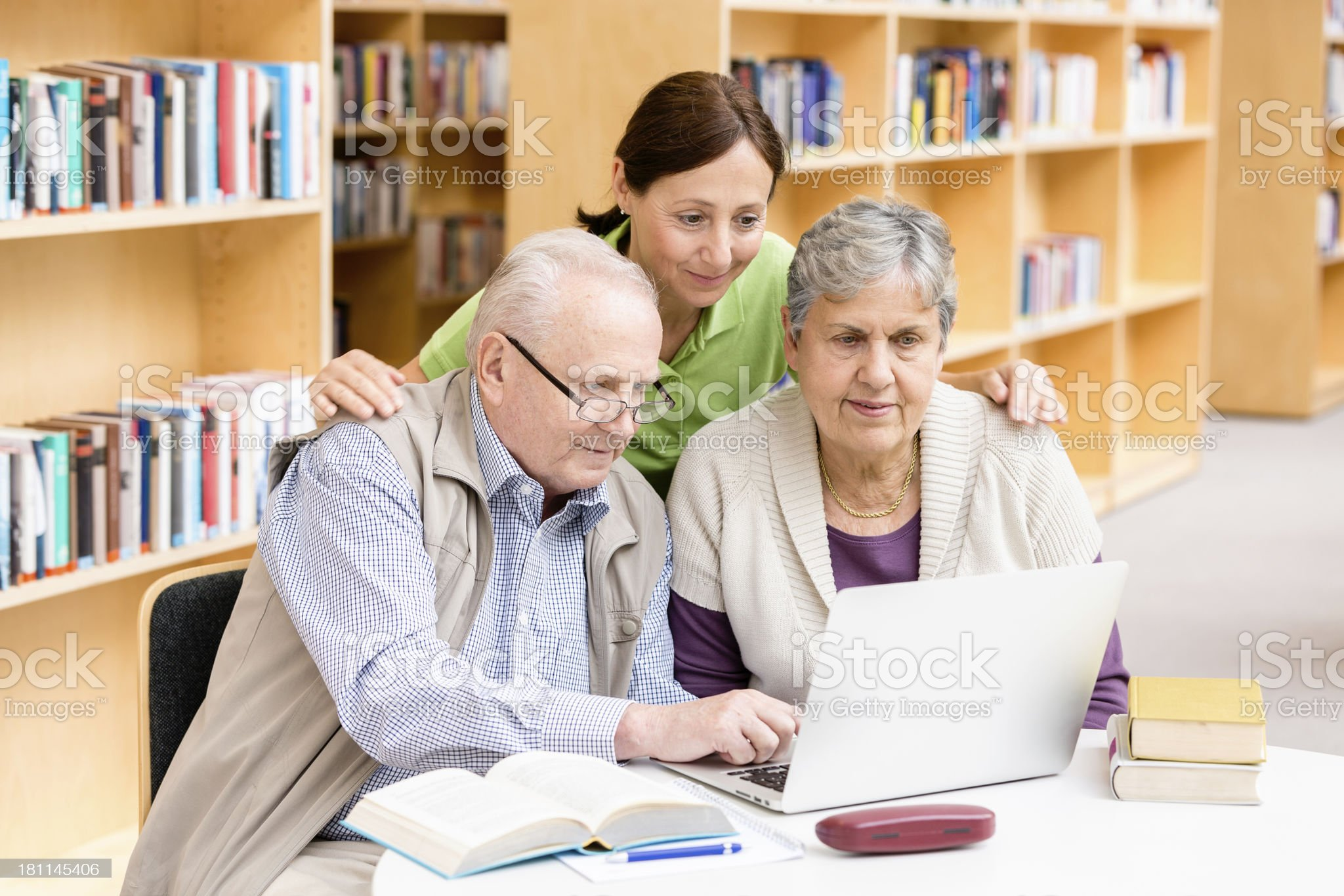Senior couple with caregiver royalty-free stock photo