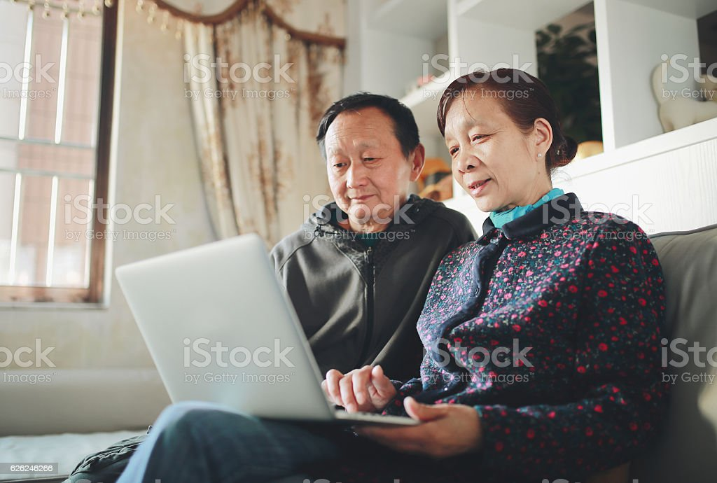 Senior couple with computer stock photo