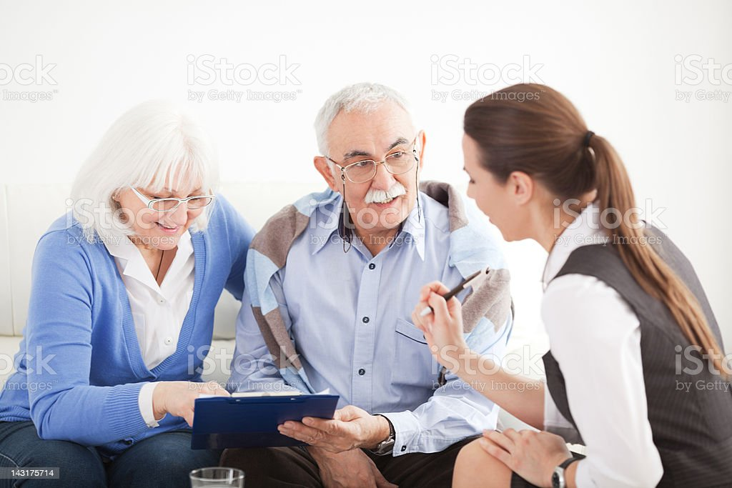 Senior couple with consultant. royalty-free stock photo