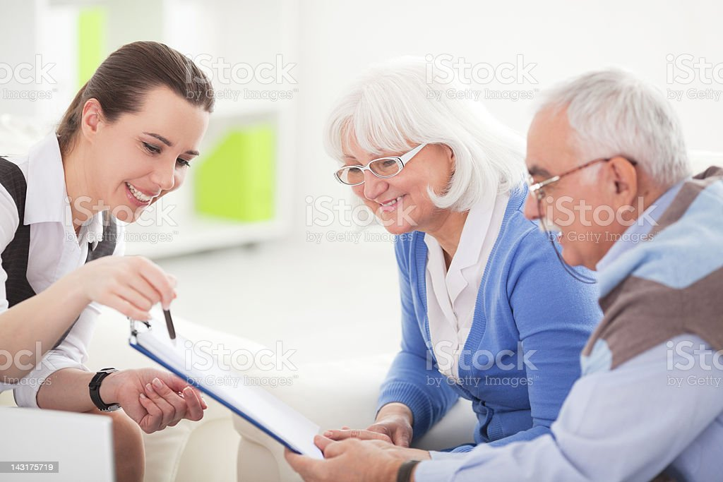 Senior couple with consultant royalty-free stock photo