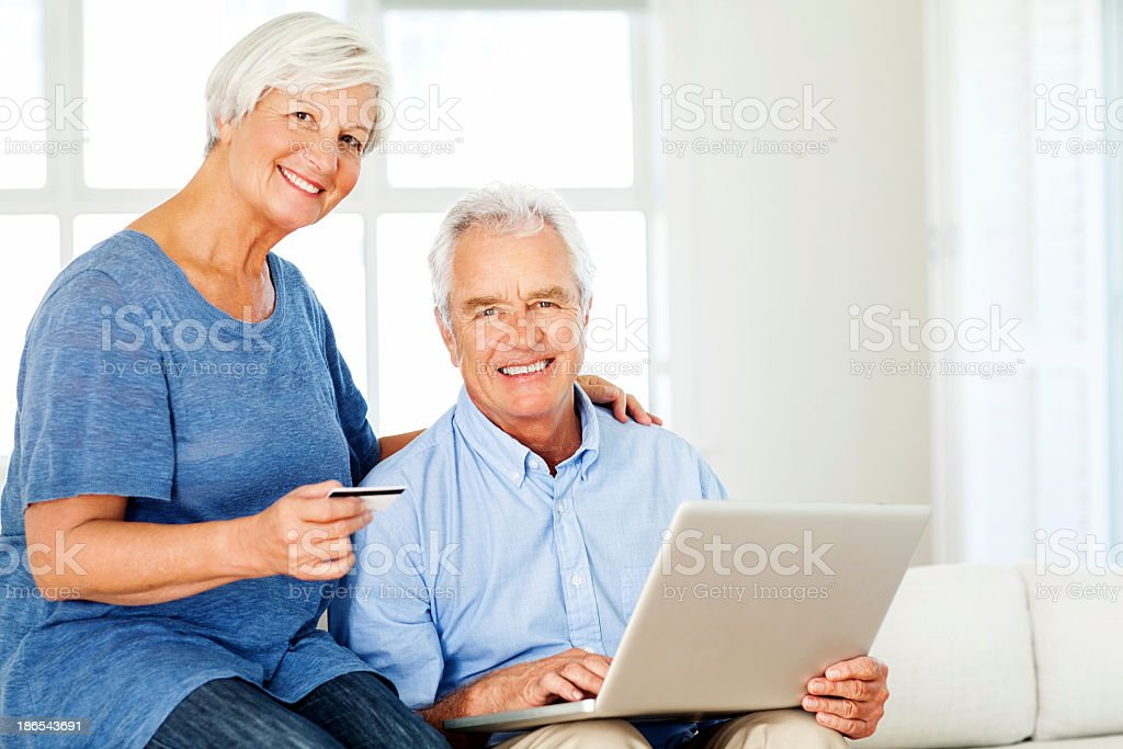 Senior Couple With Credit Card And Laptop royalty-free stock photo