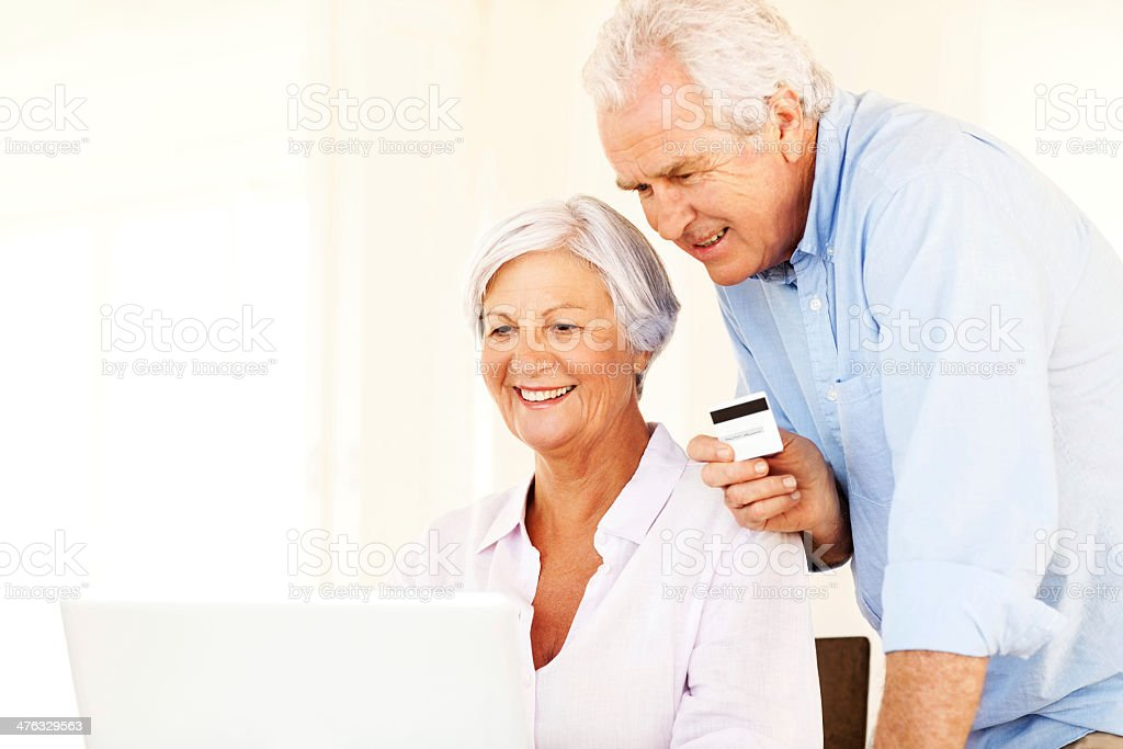 Senior Couple With Credit Card And Laptop Shopping Online royalty-free stock photo
