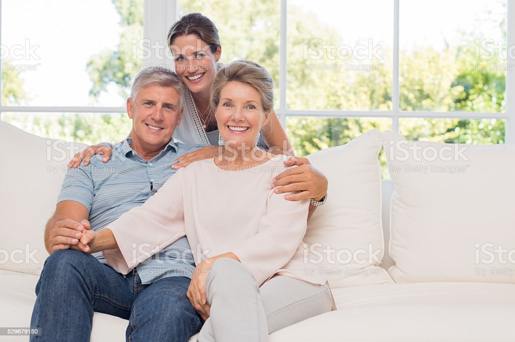 Senior couple with daughter stock photo
