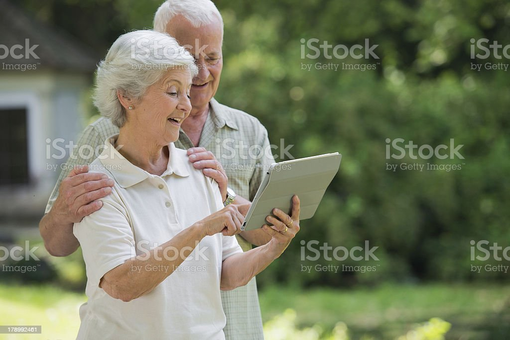 Senior couple with digital tablet device royalty-free stock photo