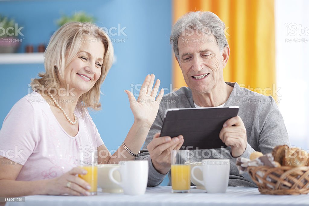Senior couple with digital tablet. royalty-free stock photo