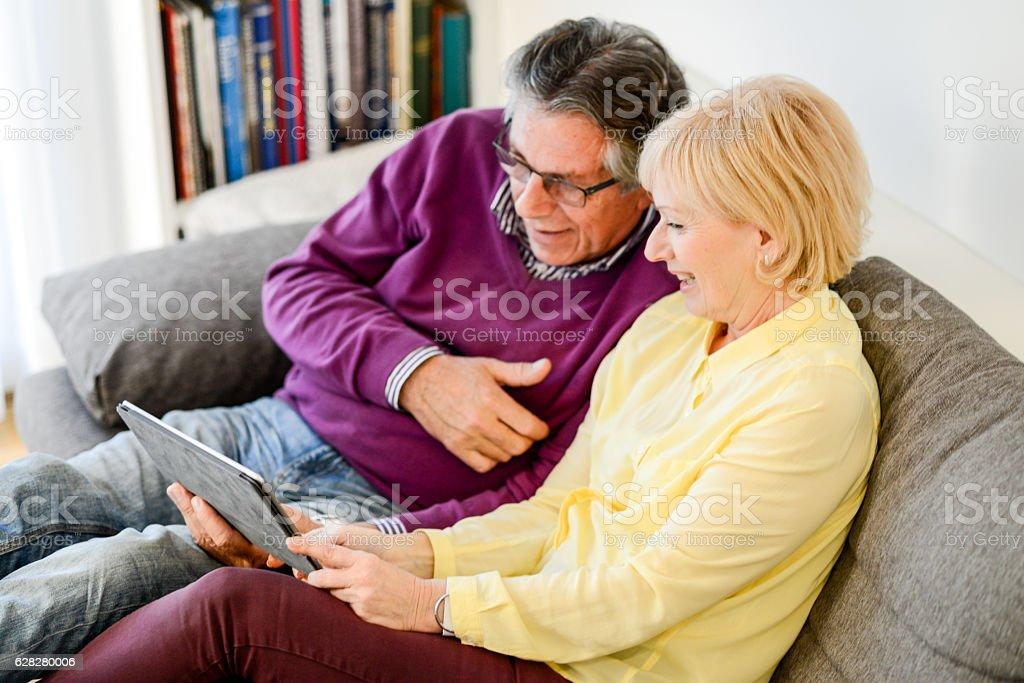 Senior couple with digital tablet stock photo