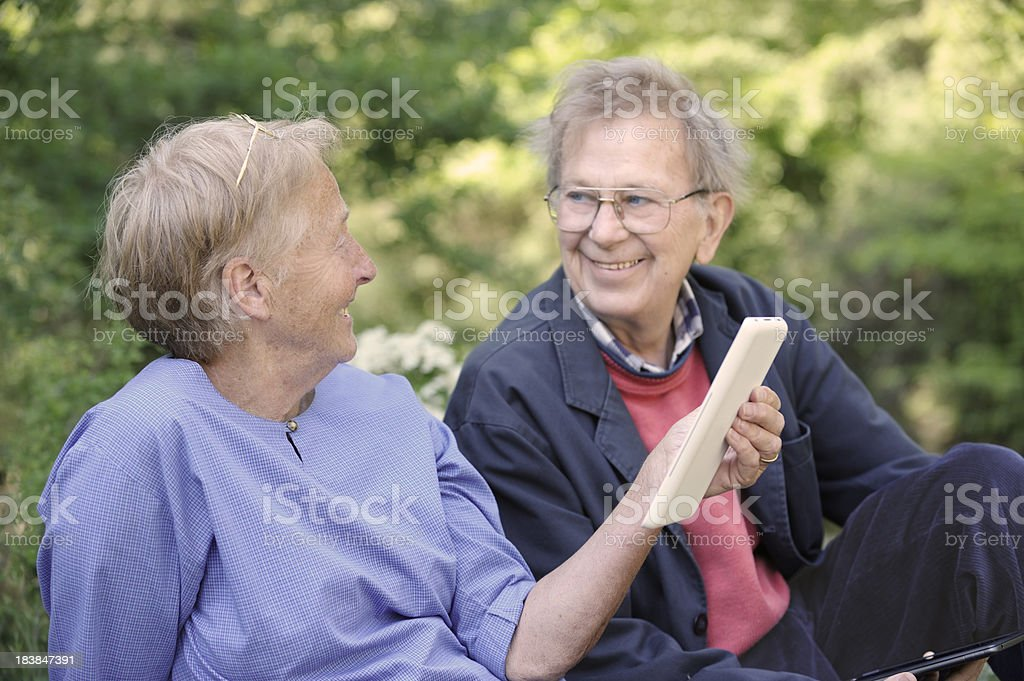 Senior couple with electronic tablets royalty-free stock photo