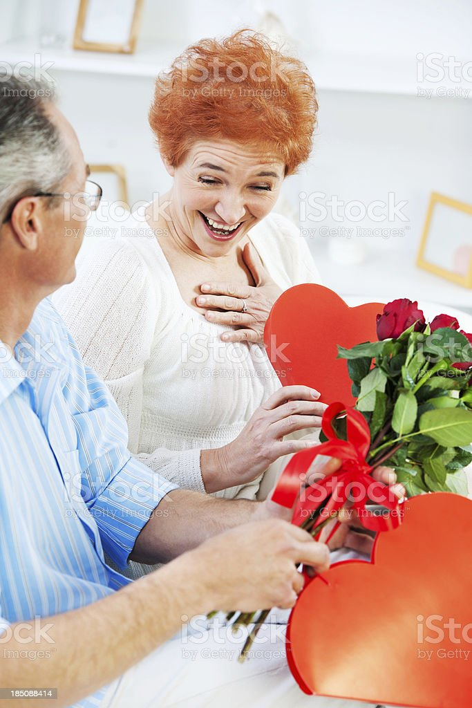 Senior couple with gifts for Valentine's Day. royalty-free stock photo