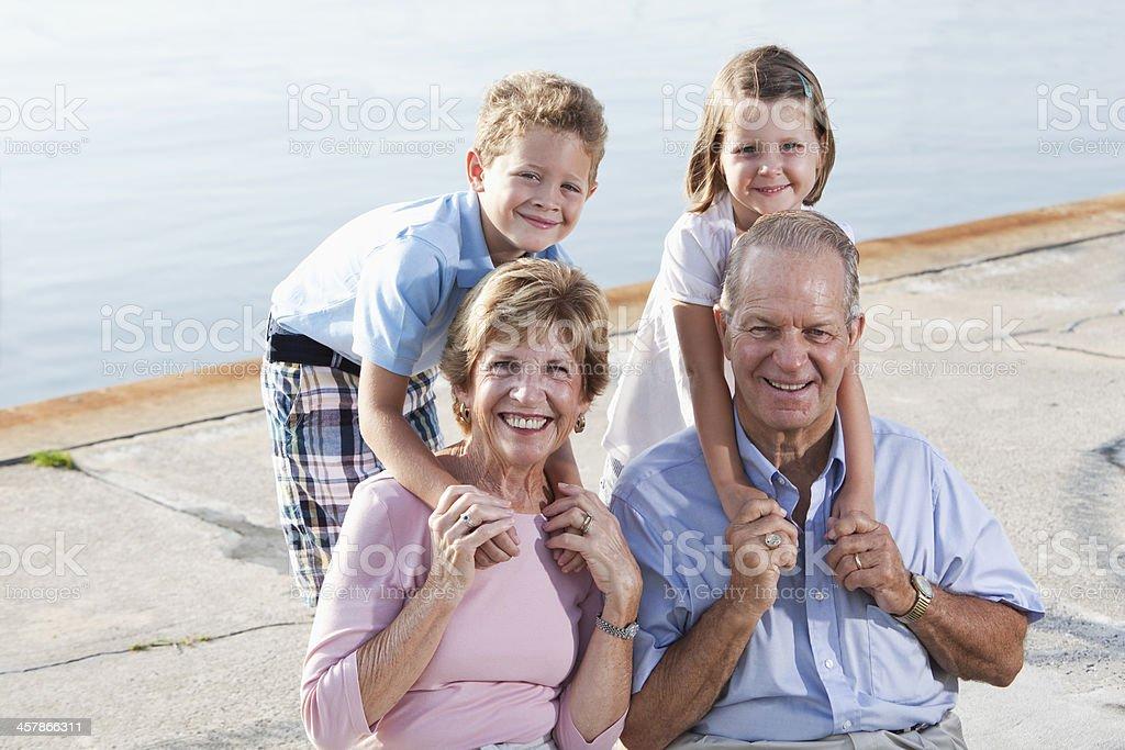 Senior couple with grandchildren royalty-free stock photo