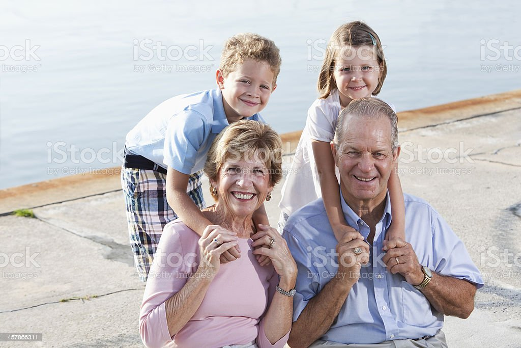 Senior couple with grandchildren stock photo