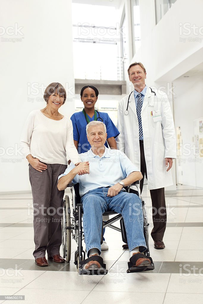 Senior couple with hospital staff stock photo