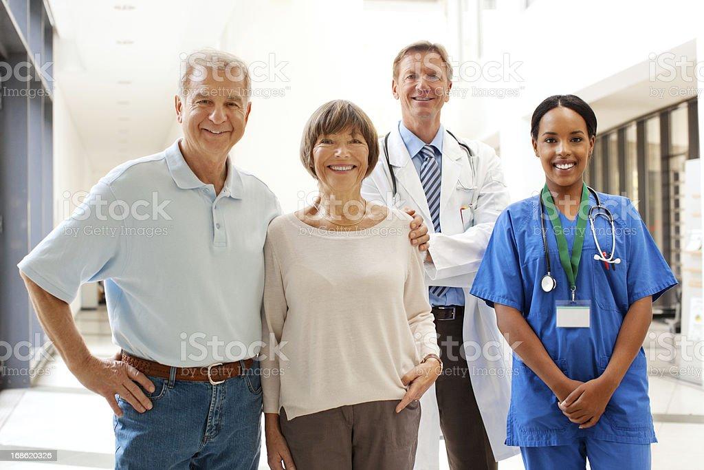 Senior couple with hospital staff stock photo