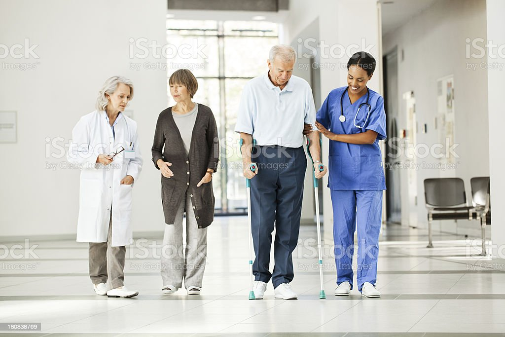 Senior couple with hospital staff royalty-free stock photo